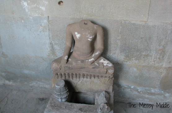 Many statutes had their heads cut off by the Khmer Rouge and sold on the black market