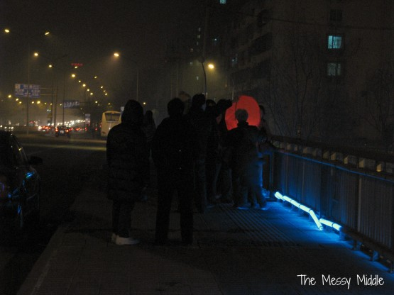 On bridge near my house, a small crowd gathered for the lighting of this lantern.